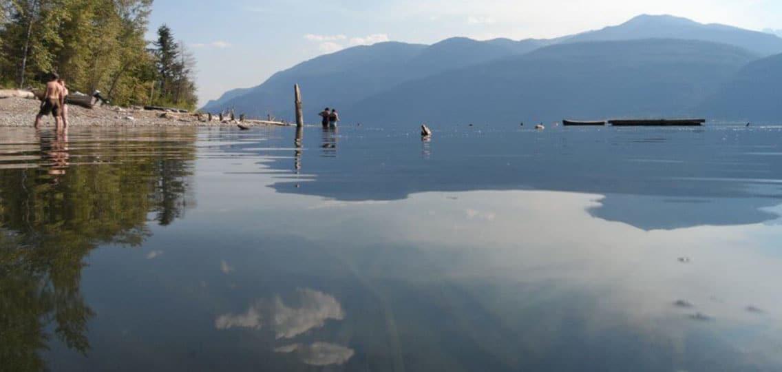 People on the shore of Kootenay Lake, B.C.
