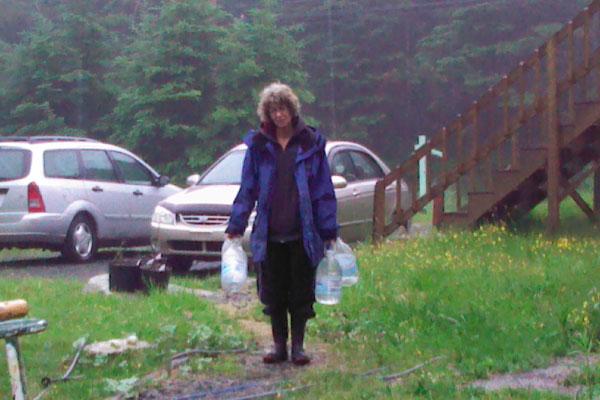 Marlene Brown gathers water from her church in Harrietsfield, Nova Scotia