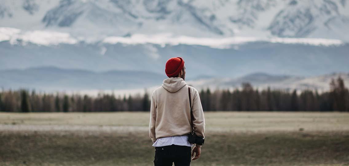 Person looking towards mountain range